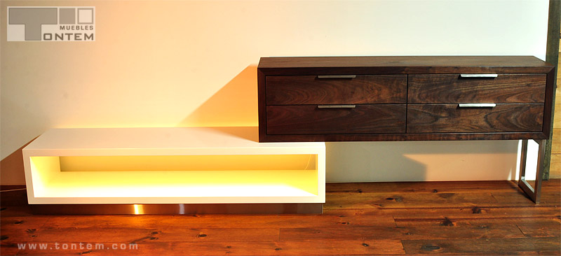 Tailor-made sideboard of hardwood and inox steel, including interior lighting